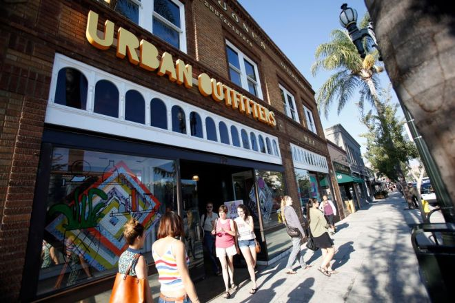 Shoppers are pictured outside a Urban Outfitters store in Pasadena